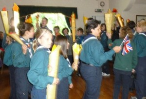 Scouts parade their homemade Olympic torch creations
