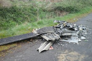 Fly tipped rubbish at edge of a road