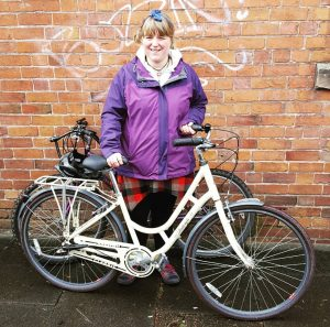Lady with a white bicycle from the re-cycle scheme